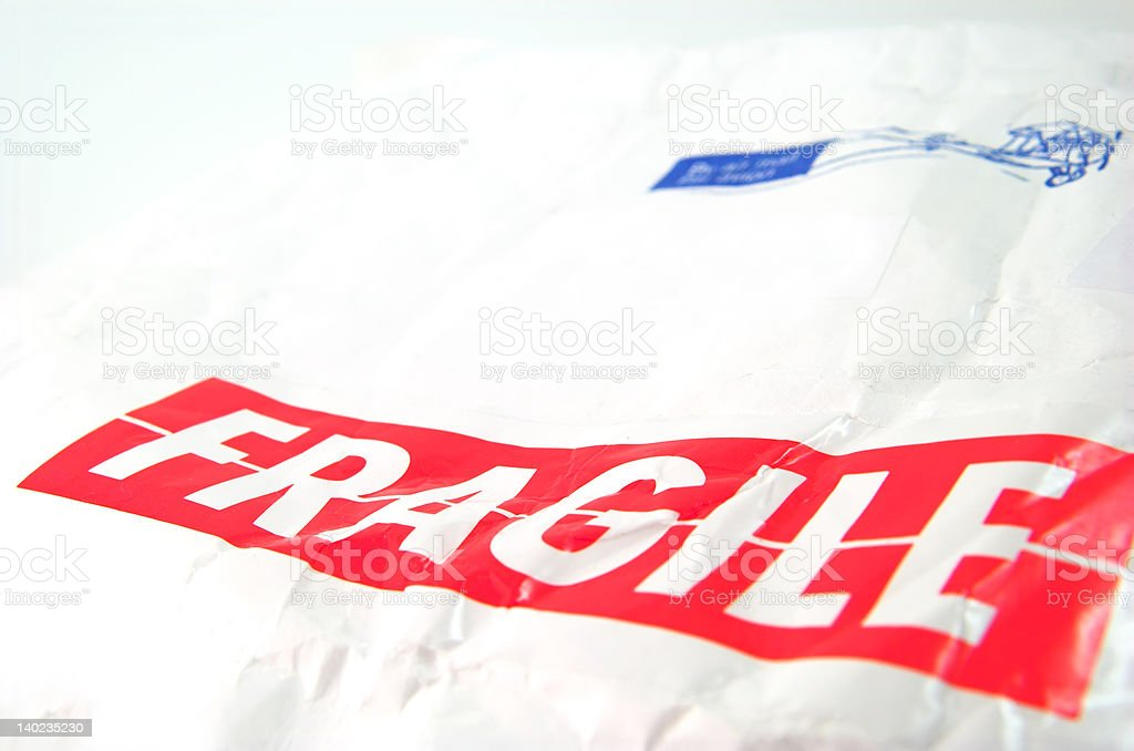 fragile tag and old white envelope stock photo