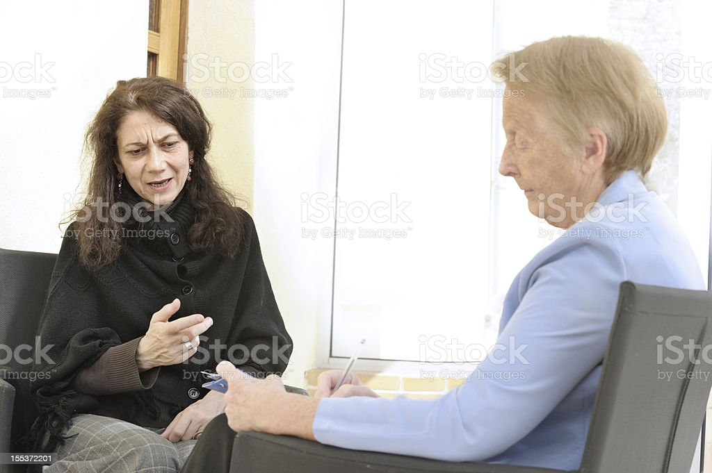 Fragile woman in counselling session royalty-free stock photo