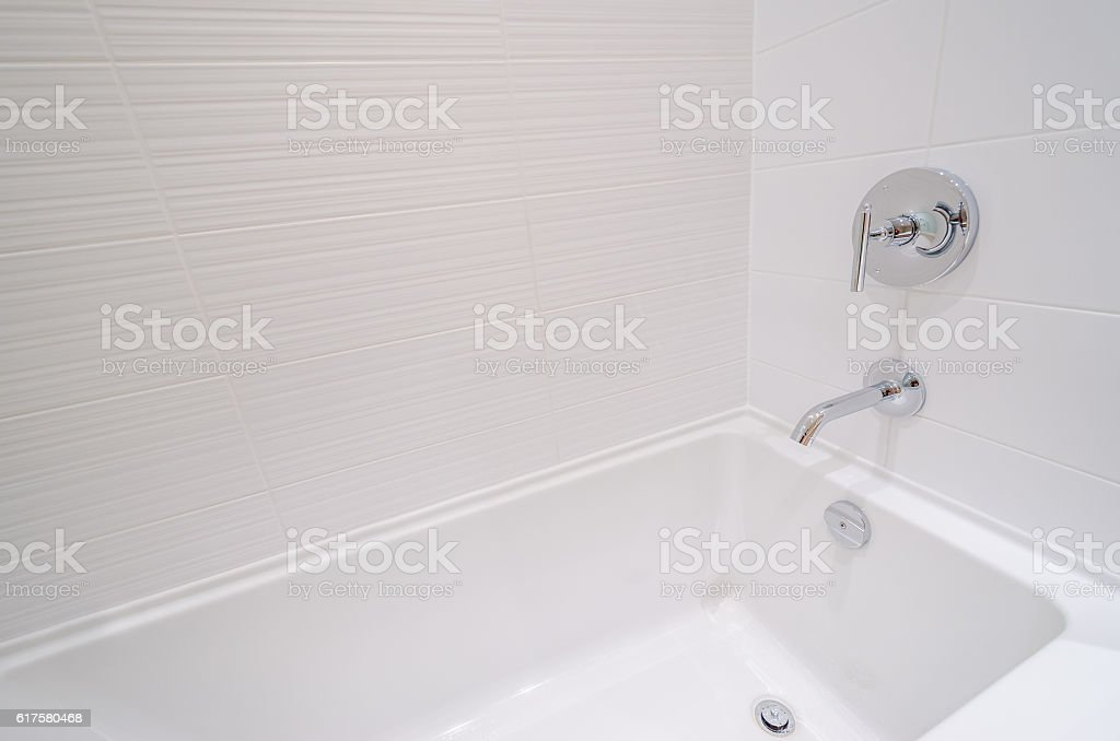 Fragment of a luxury bathroom with a detail of bathtub. stock photo