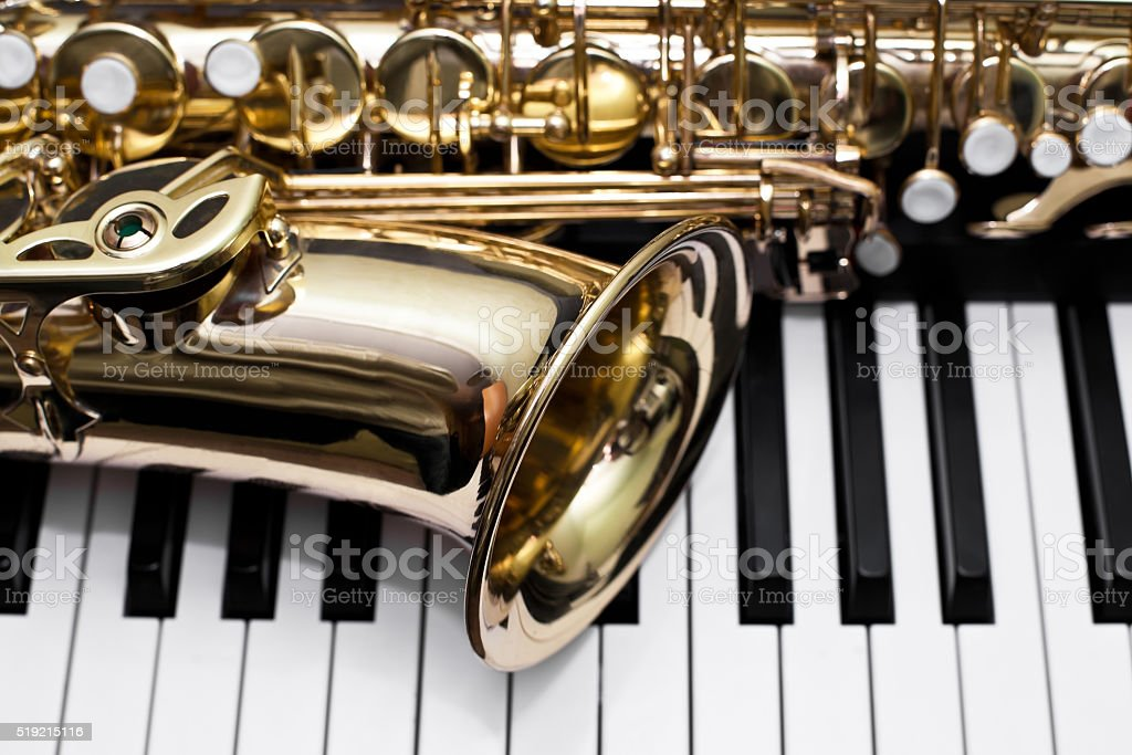 Fragment of a saxophone stock photo