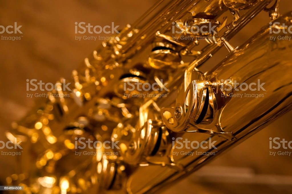 Fragment of a saxophone valves stock photo