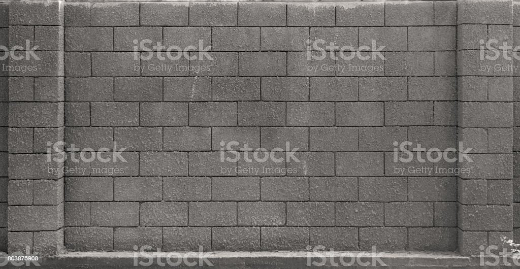 Fragment of a wall of stone blocks stock photo