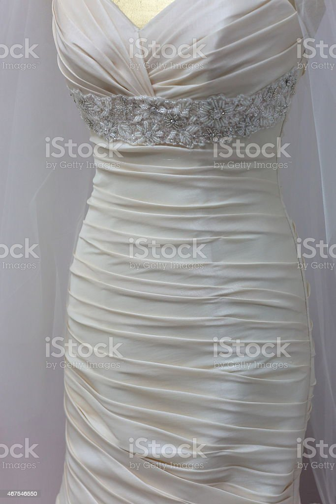Fragment of a wedding dress stock photo