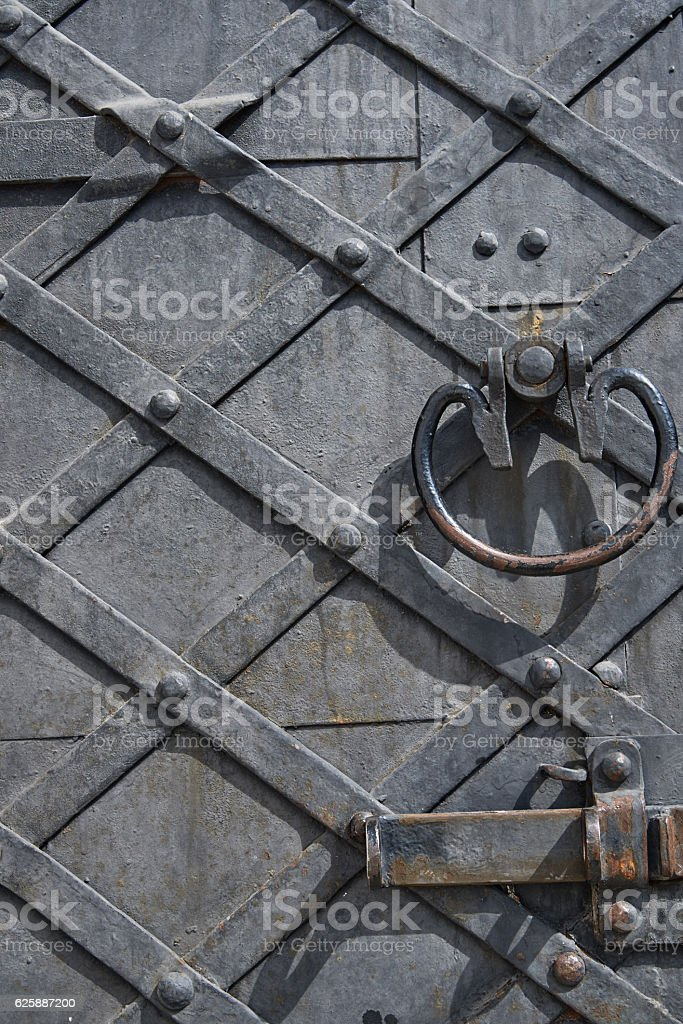 Fragment of an old wooden door with metal handle royalty-free stock photo