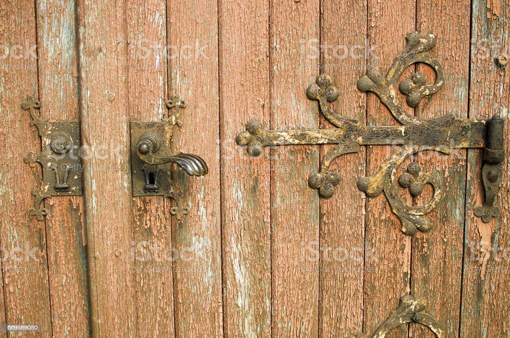 Fragment of ancient door closeup stock photo