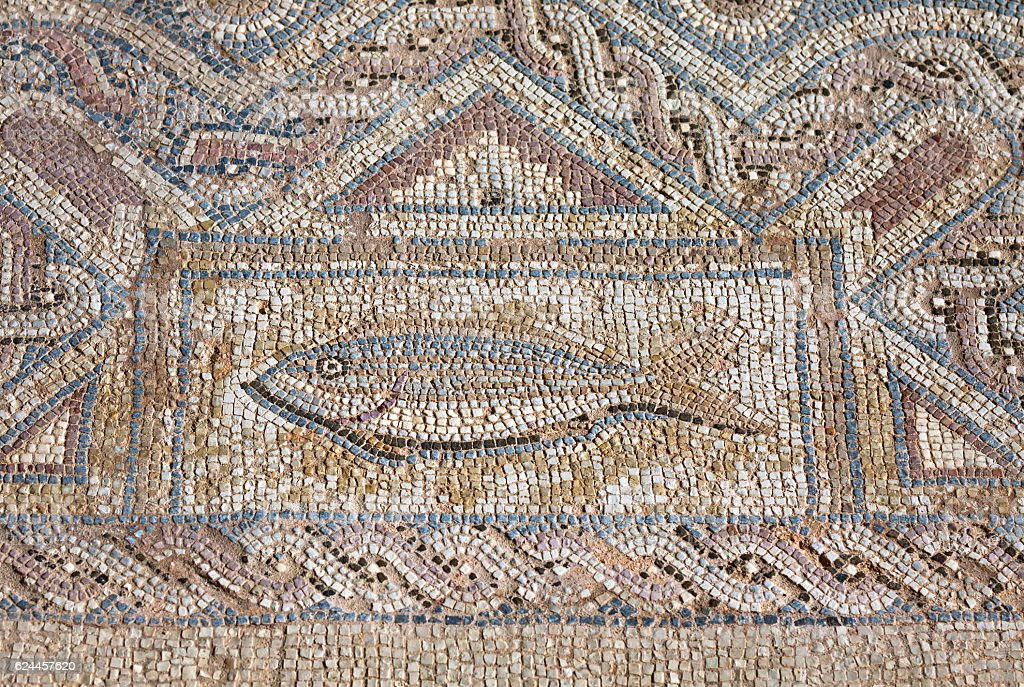 Fragment of ancient religious mosaic stock photo