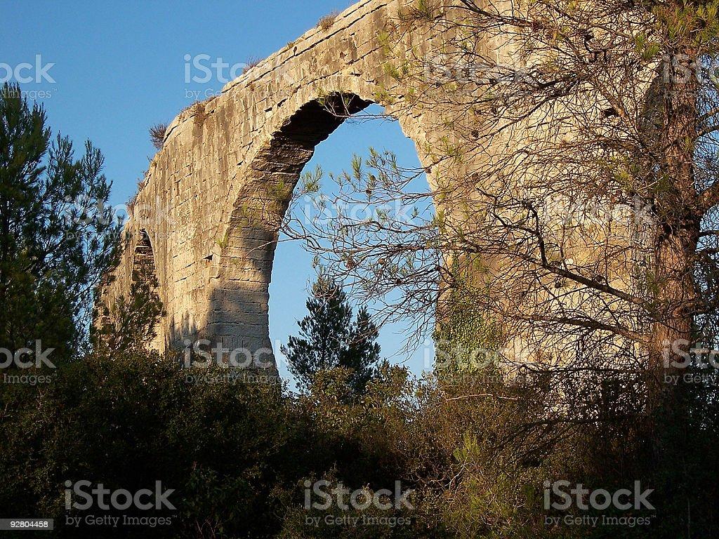 Fragment of aqueduct at sunset stock photo