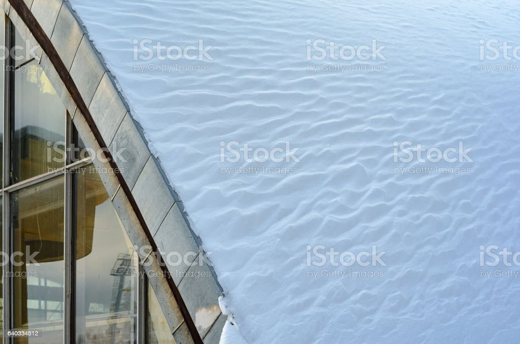 Fragment of arched roof with snow stock photo
