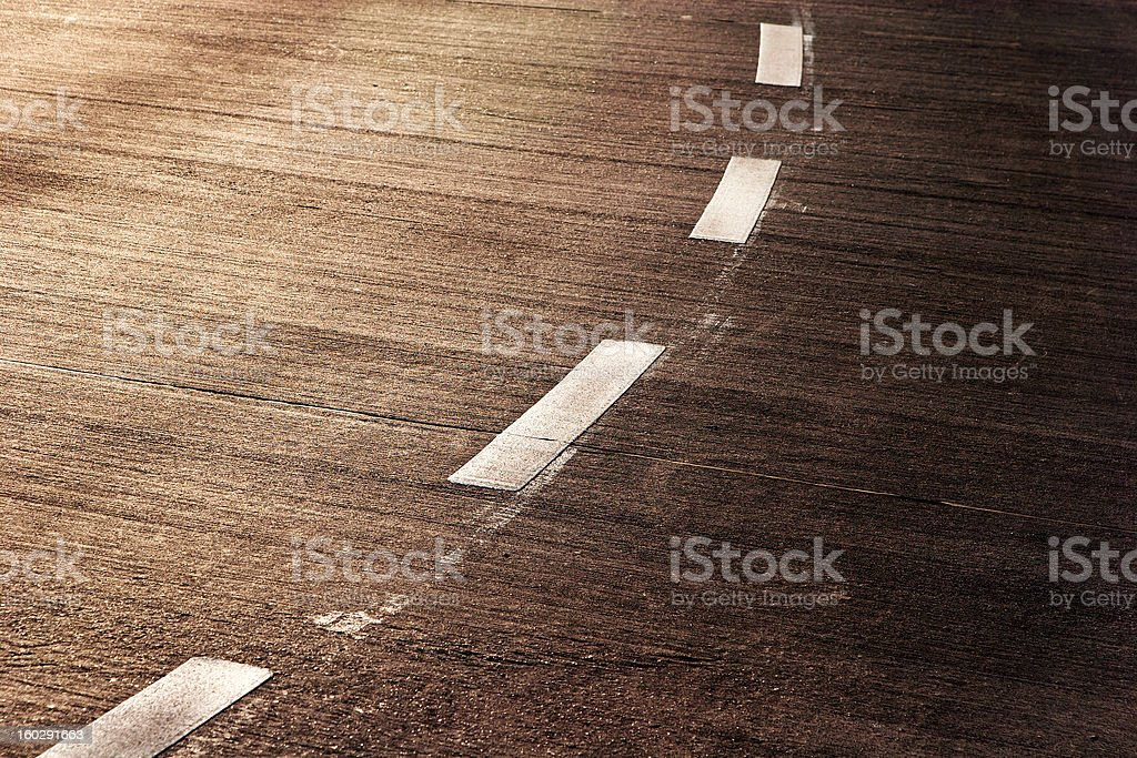 Fragment of asphalt road in the sunlight royalty-free stock photo