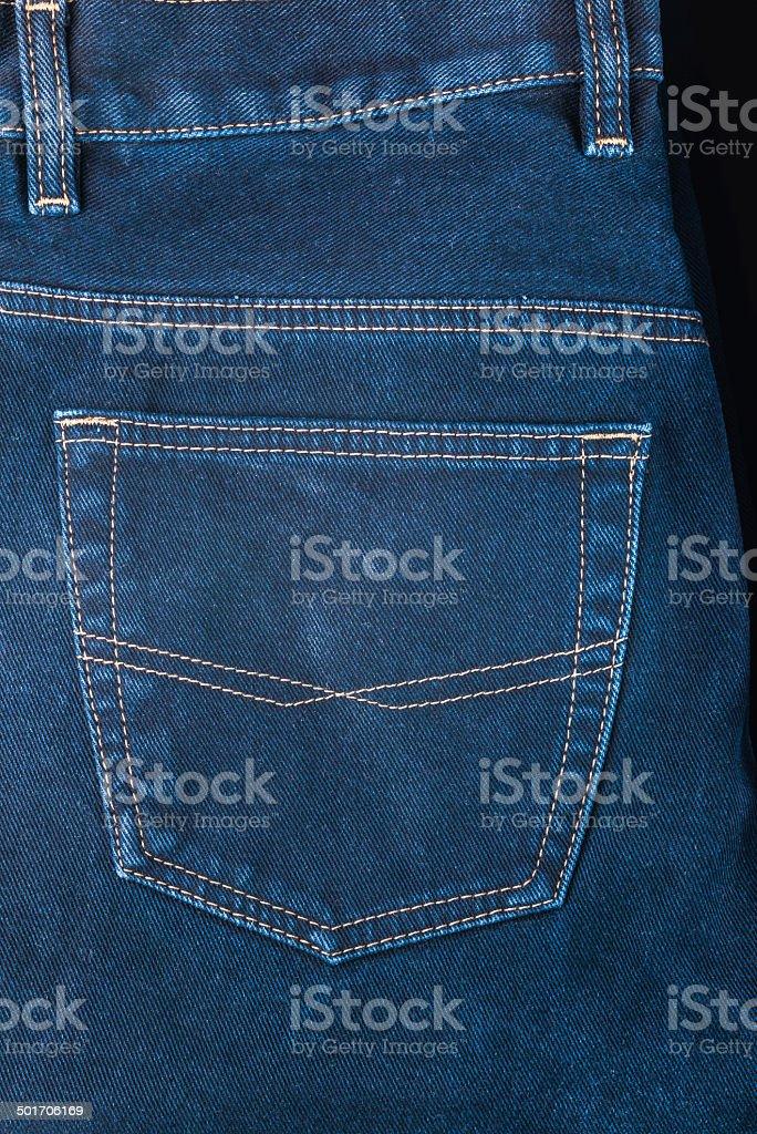 fragment of back pocket blue jeans, background royalty-free stock photo