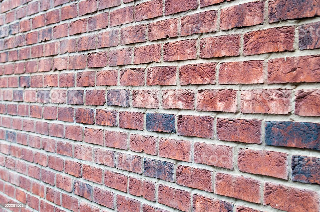 Fragment of brown brick wall stock photo