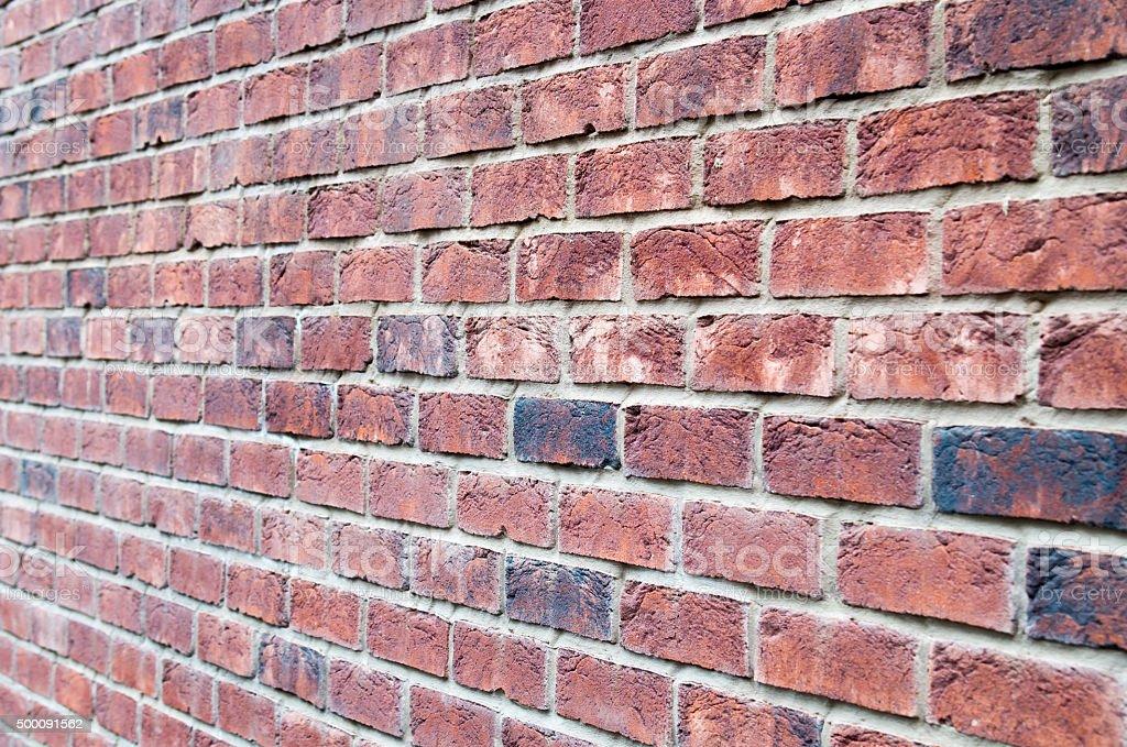 Fragment of brown brick wall stock photo