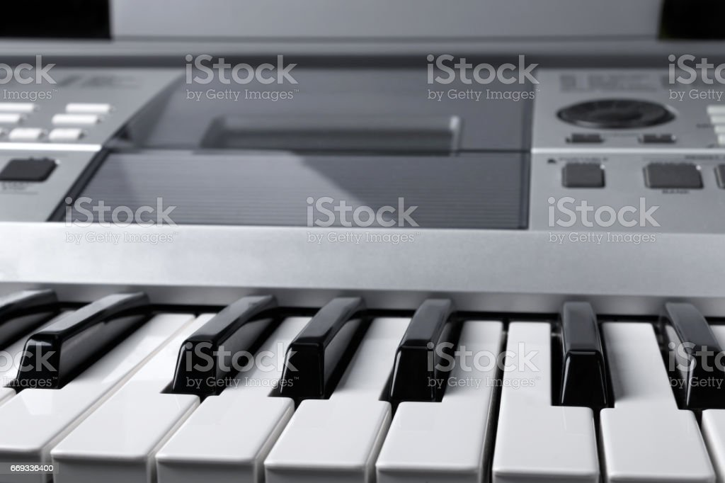 Fragment of electronic synthesizer keyboard with control buttons stock photo