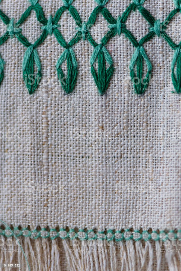fragment of embroidered ornament on a linen napkin stock photo