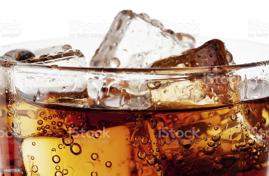Fragment of glass cola with ice stock photo
