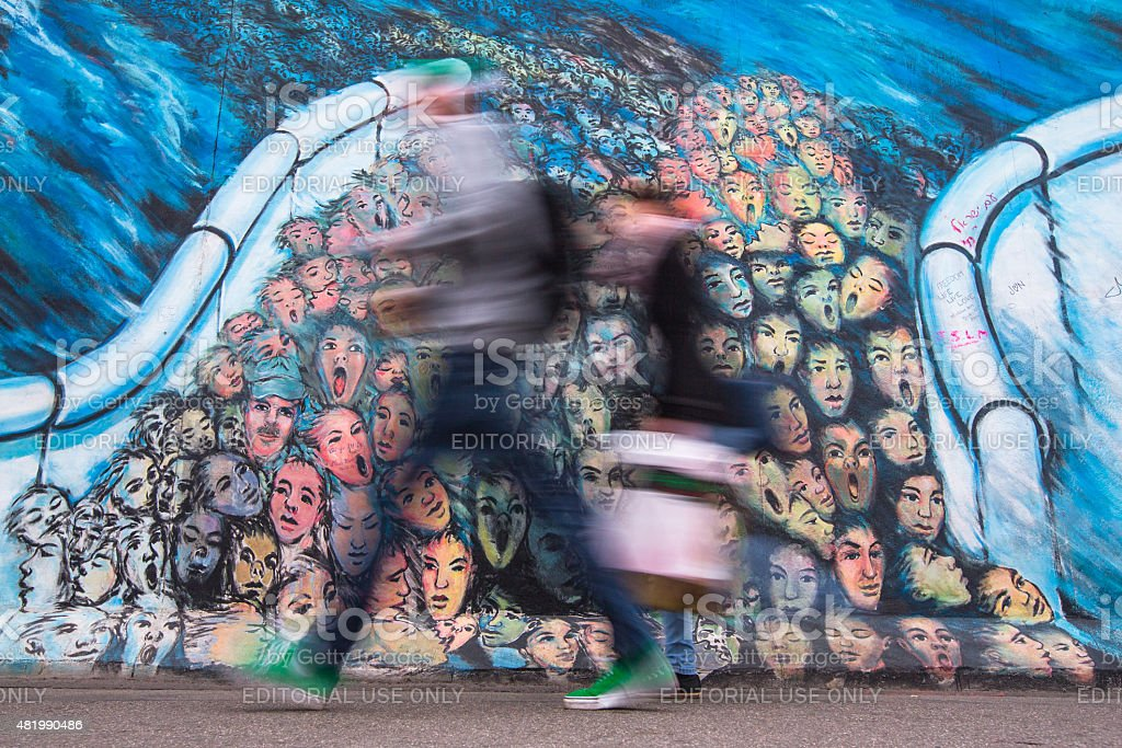 Fragment of graffiti on Berlin Wall at East Side Gallery stock photo