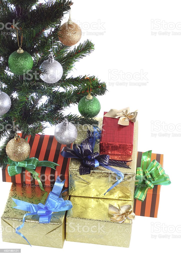Fragment of New Year Tree with gift boxes royalty-free stock photo