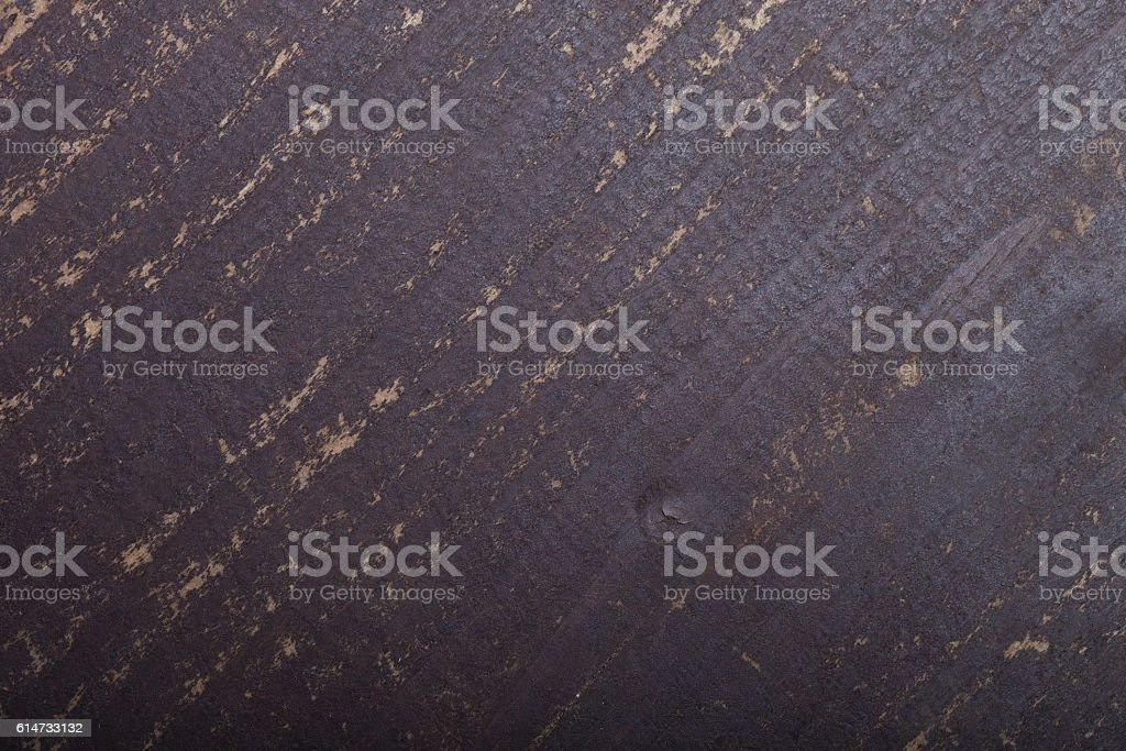 Fragment of old painted wooden door. Toned stock photo