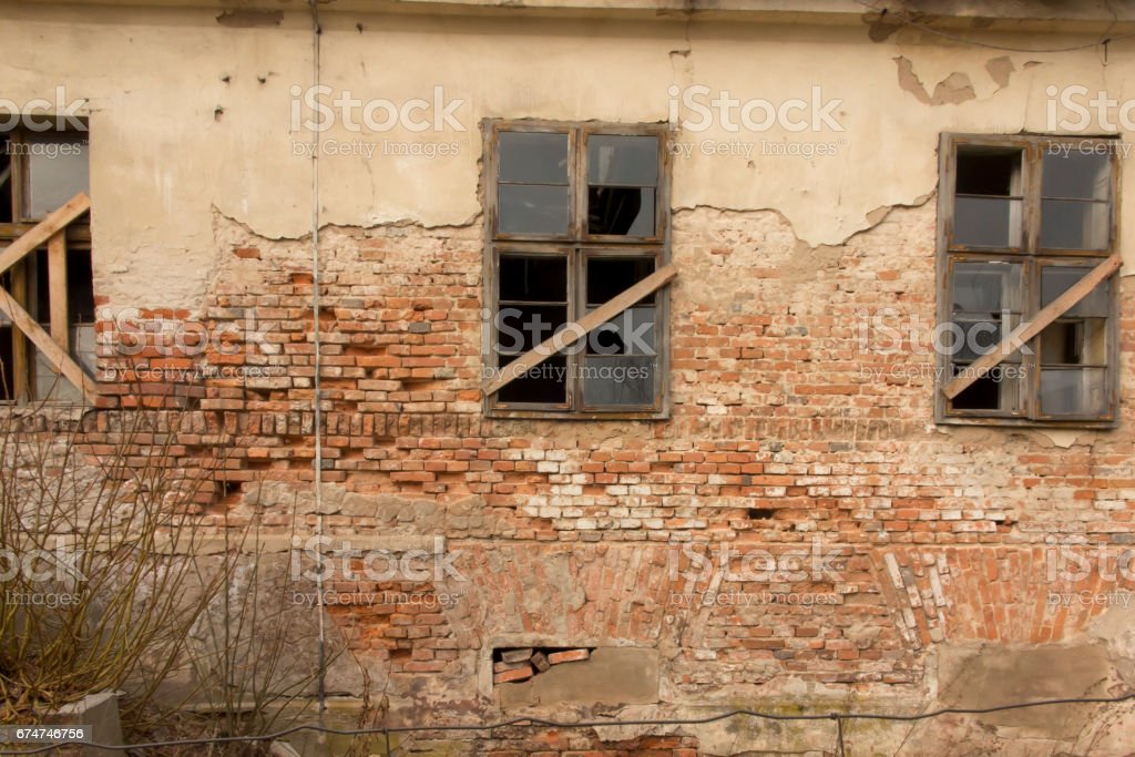 Fragment of old ruined house stock photo