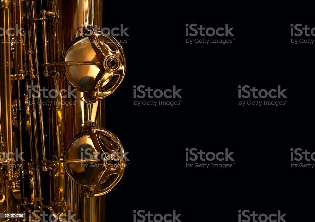 Fragment of saxophone valves stock photo