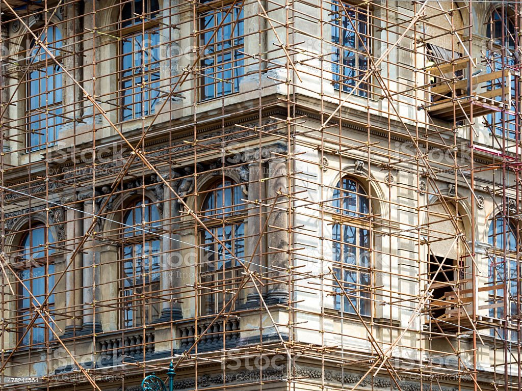 Fragment of scaffolding against house wall in Prague stock photo