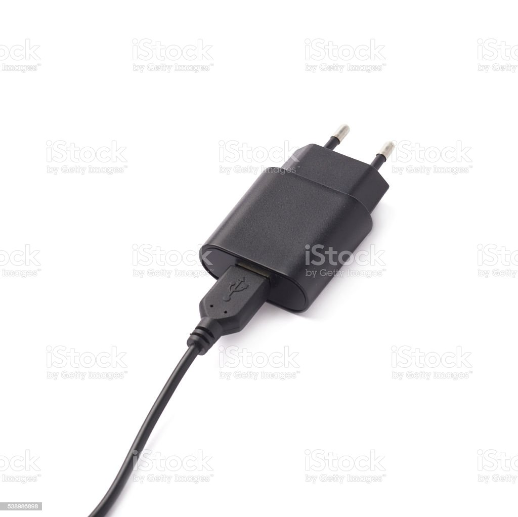 Fragment of the black adapter charger isolated stock photo
