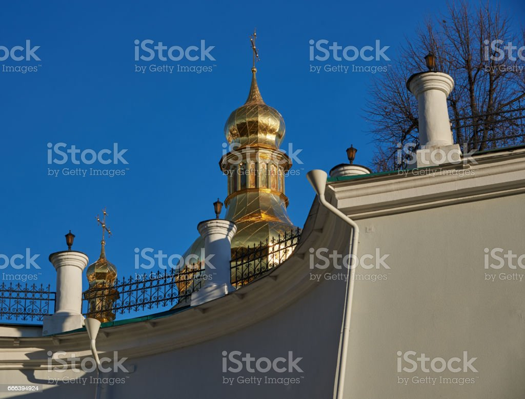 Fragment of the retaining wall of the Kiev Pechersk Lavra. Behind the wall you can see the golden domes of the Orthodox church stock photo