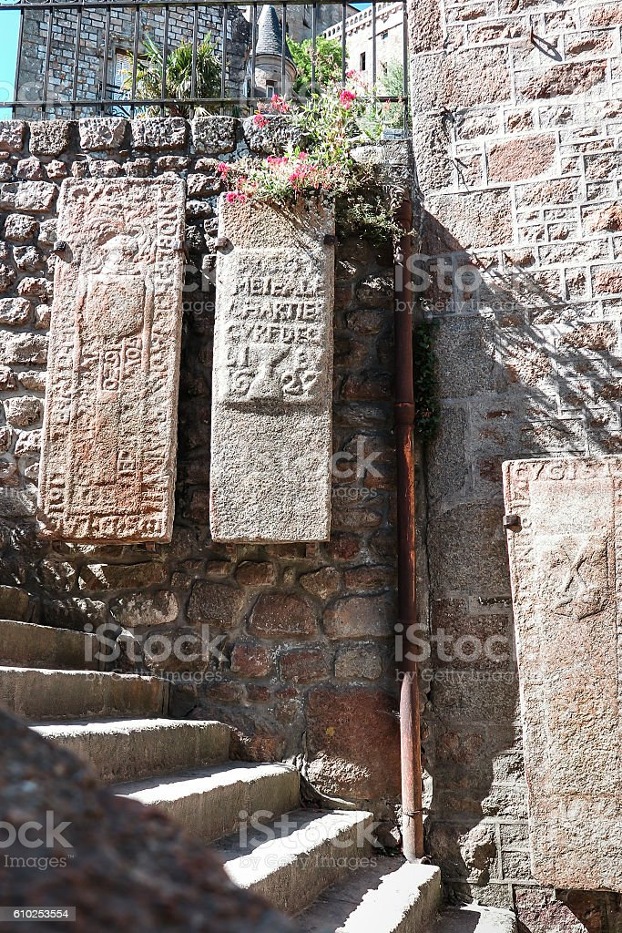 Fragment of the wall with old stone slabs, Mont-Saint -Michel stock photo