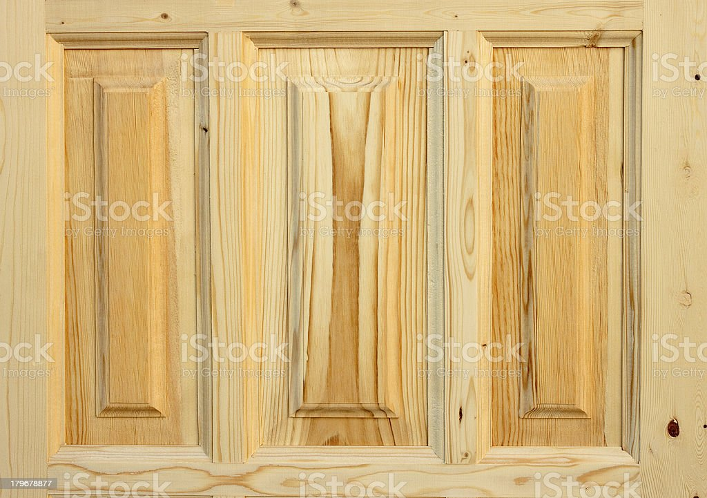 Fragment wooden door made of coniferous tree royalty-free stock photo