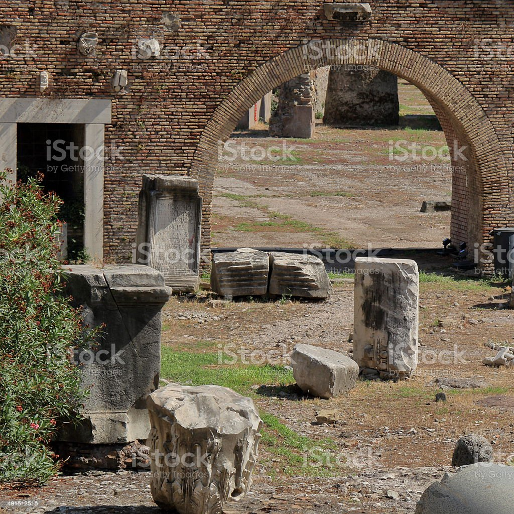 Fragments of broken columns and ancient arch stock photo