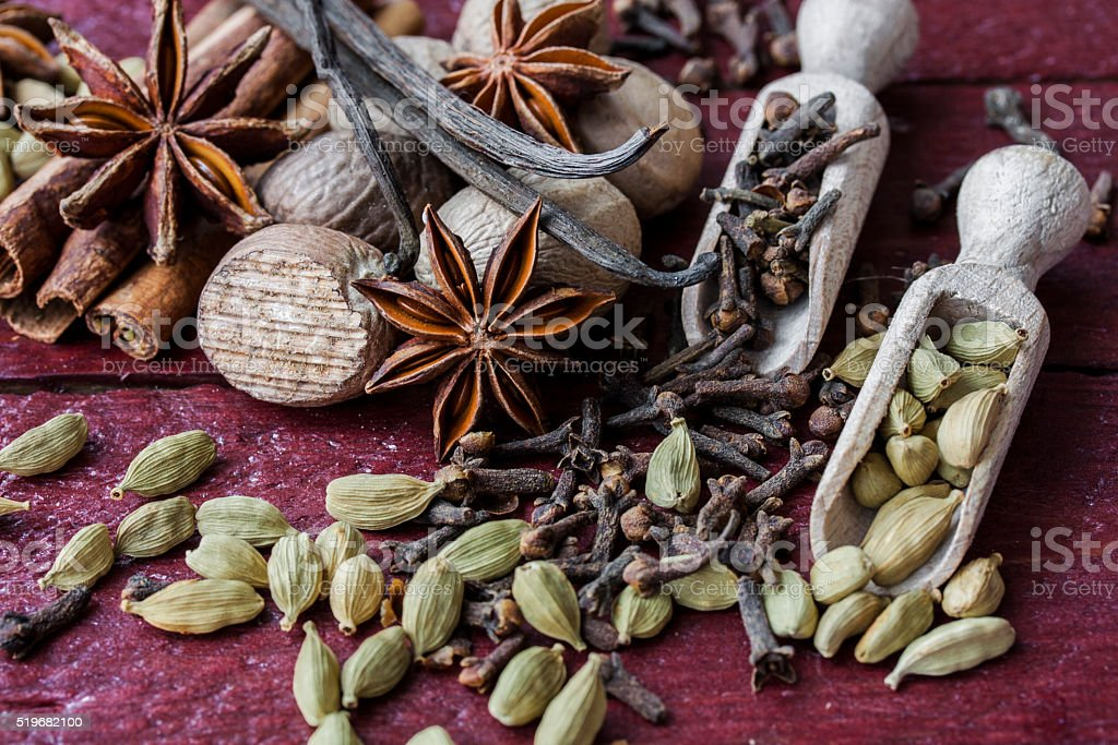 fragrant spices in wooden scoops stock photo