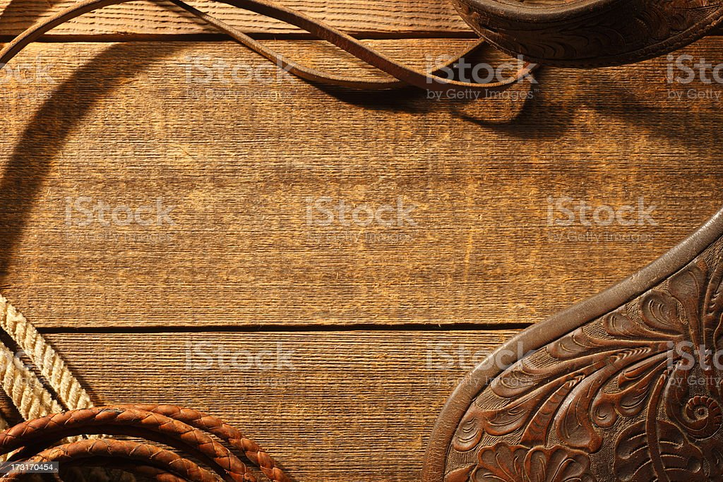 Frame created by horse riding tack on rustic brown wood stock photo