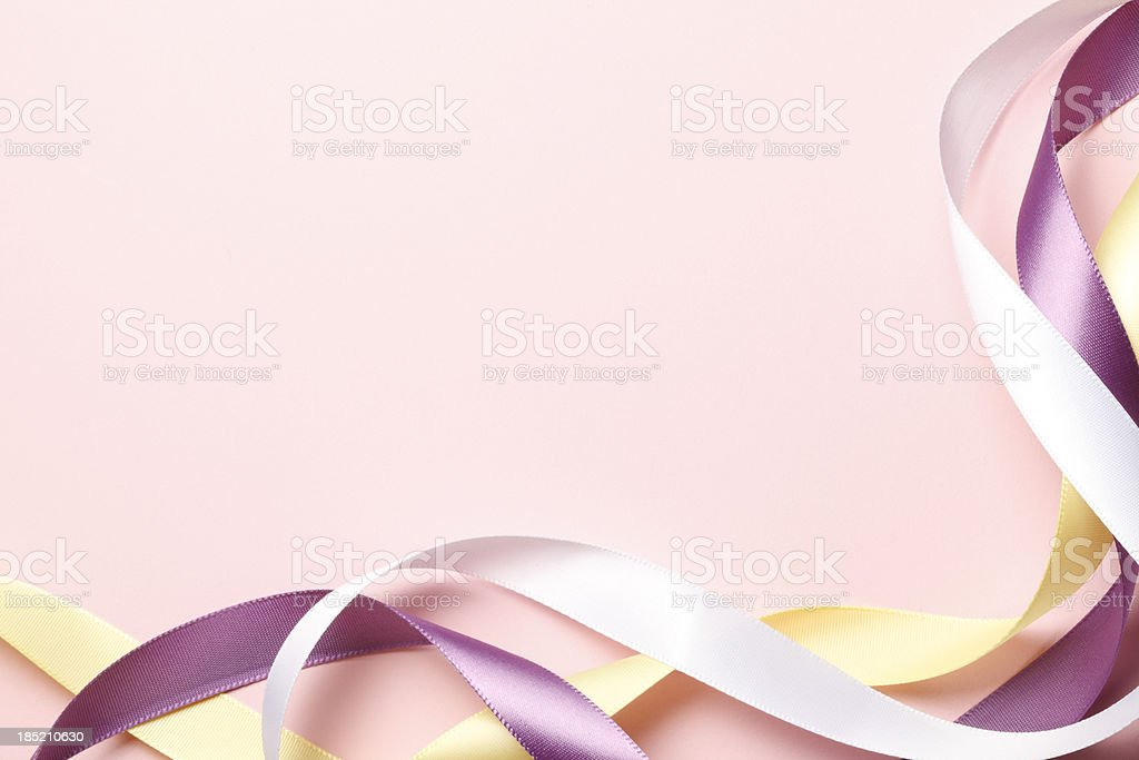 Frame created by ribbons on pink background royalty-free stock photo