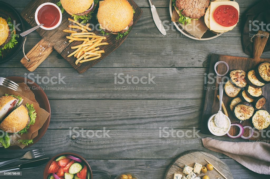 Frame from different burgers with grilled vegetables stock photo