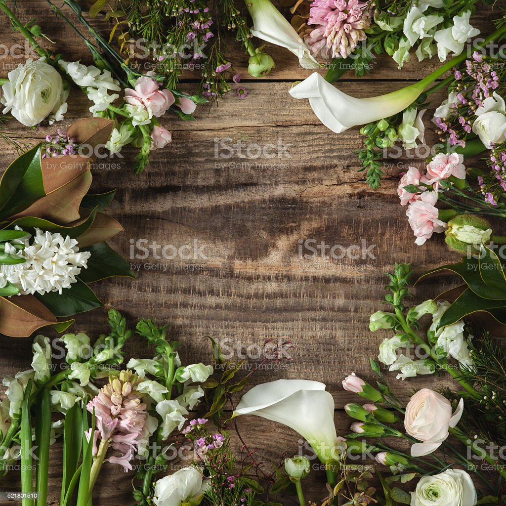 Frame from flowers on wooden background stock photo