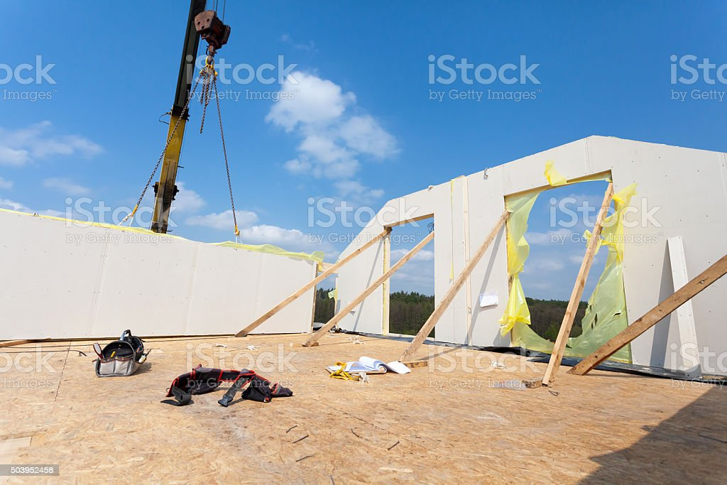 Frame house construction. Installation finished walls on the second floor stock photo