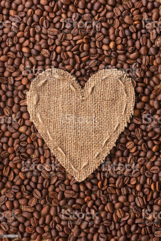 Frame in the shape of heart made with coffee beans stock photo