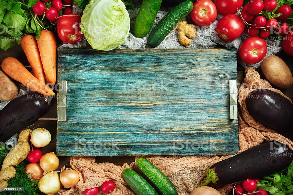Frame made from fresh vegetables on wooden stock photo