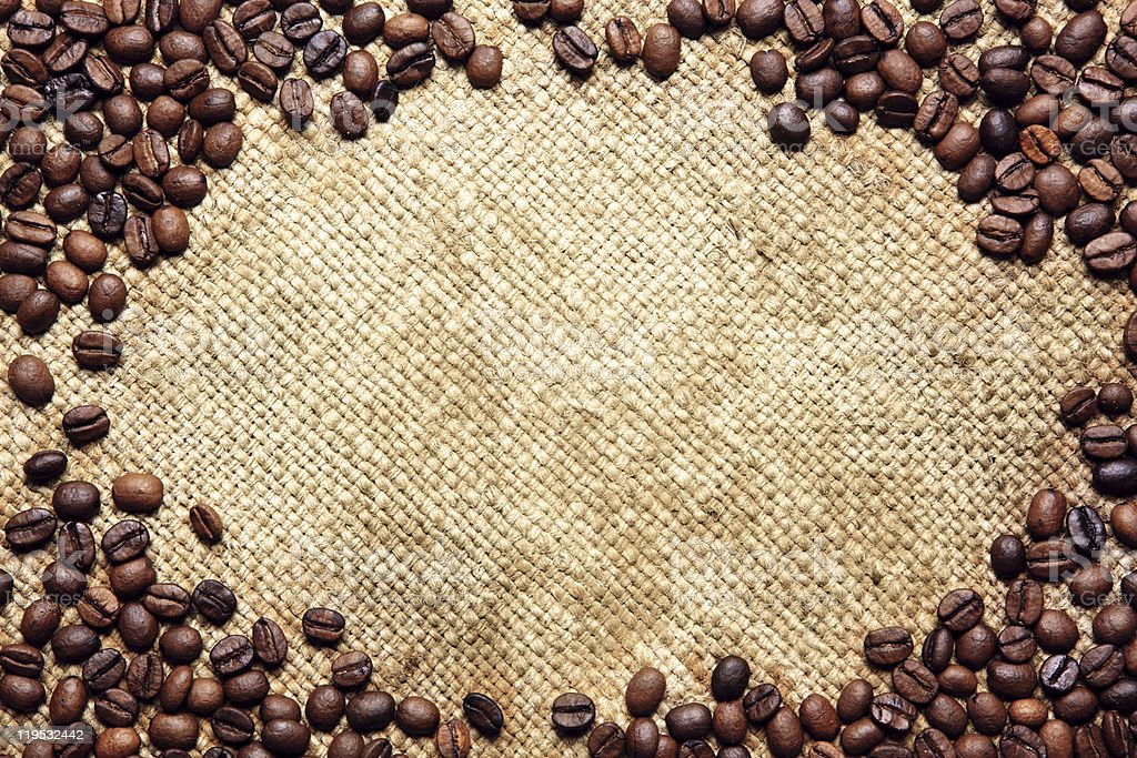 Frame made of coffee beans on traditional sack textile royalty-free stock photo