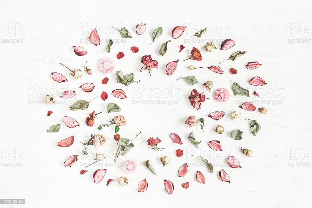 Frame made of dried flowers and leaves. Flat lay stock photo