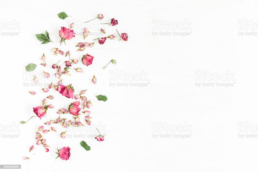 Frame made of dried rose flowers. Valentine's Day. Flat lay stock photo