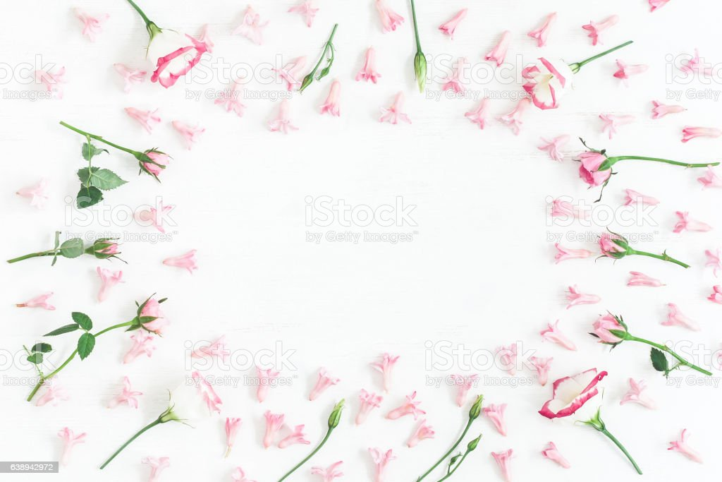 Frame made of pink flowers. Valentine's Day. Flat lay stock photo