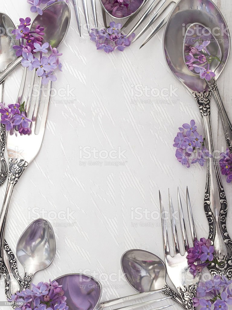 frame made of spoons and forks with flowers royalty-free stock photo