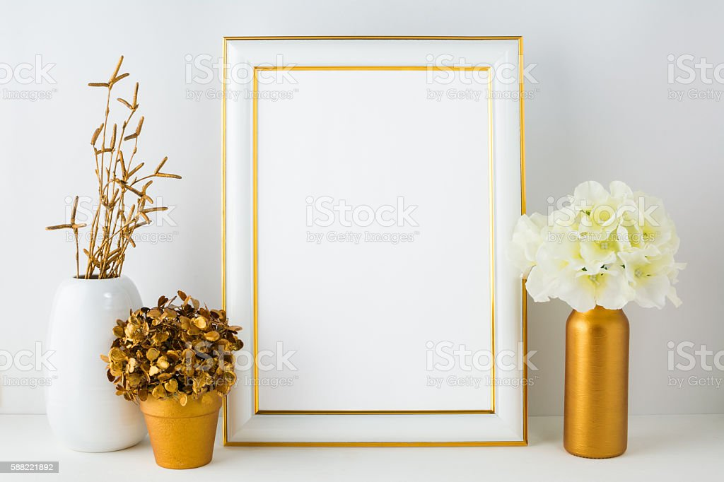 Frame mockup with ivory hydrangea in the  golden vase stock photo