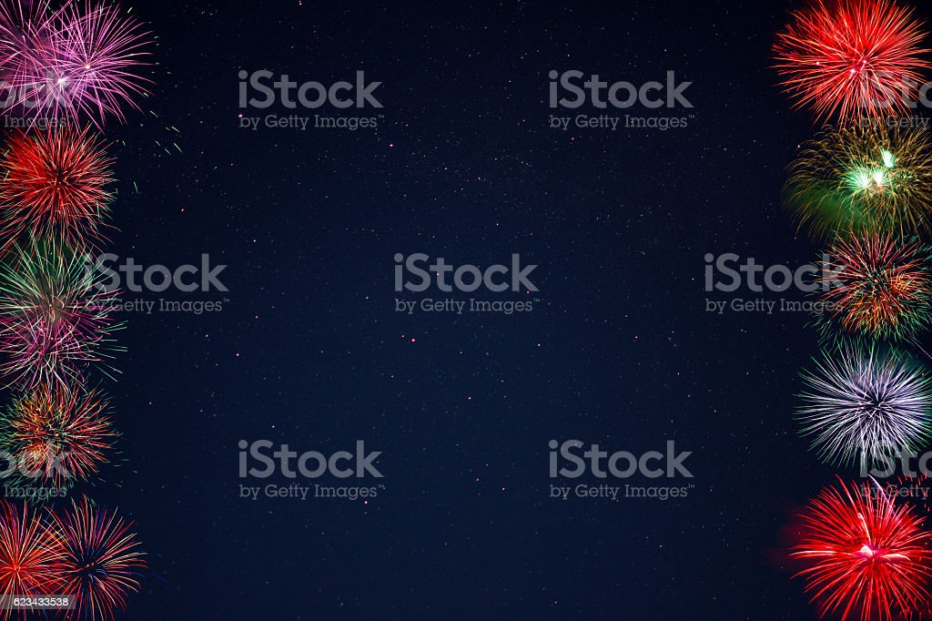Frame of beautiful celebration fireworks over night sky, copy sp stock photo