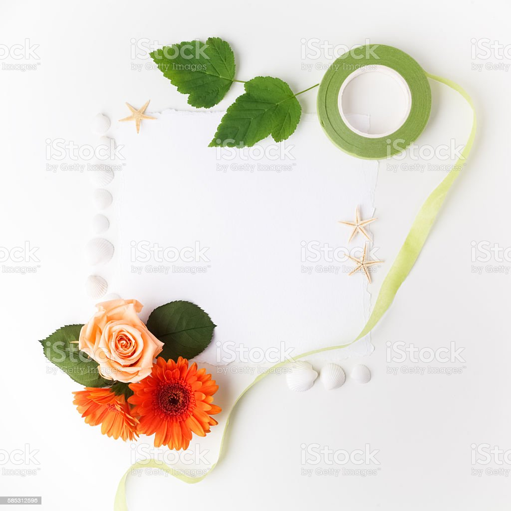Frame of flowers on a white table ,with space for stock photo