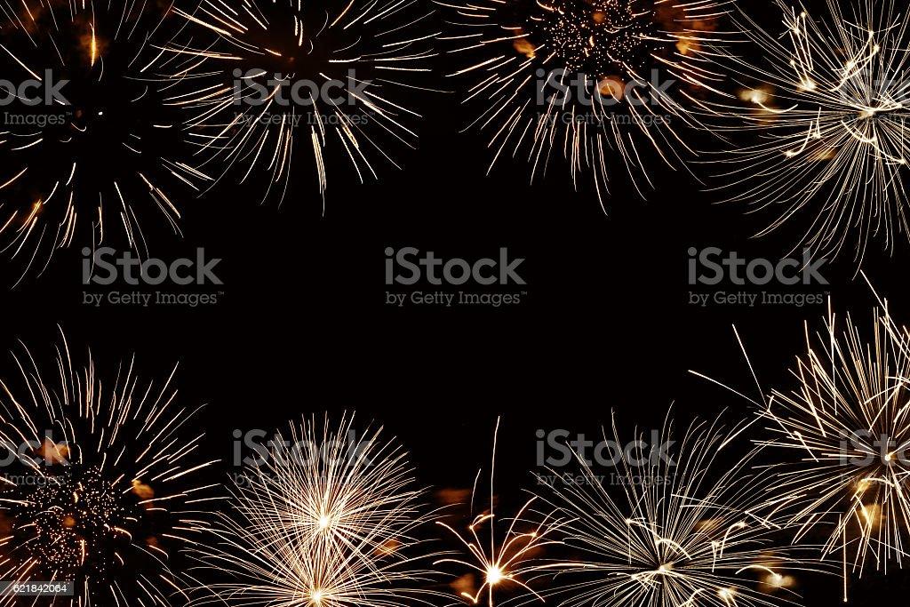 Frame of golden fireworks, black night background stock photo
