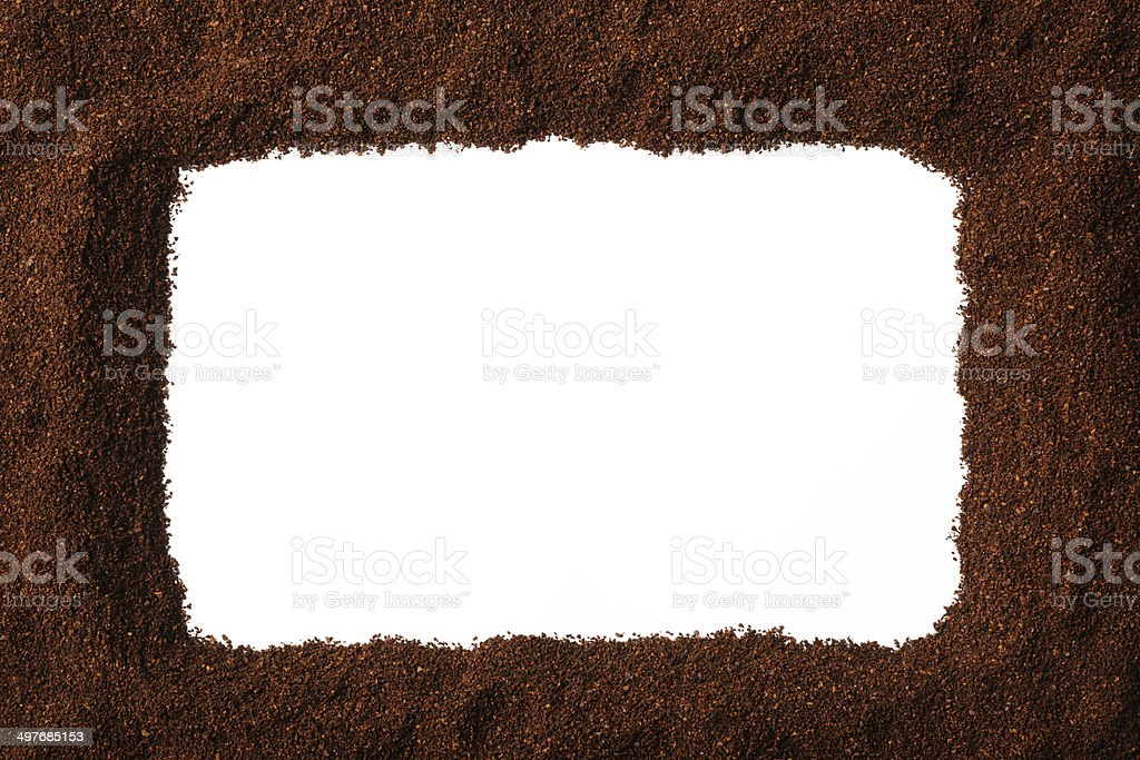 Frame of ground coffee beans on white background royalty-free stock photo
