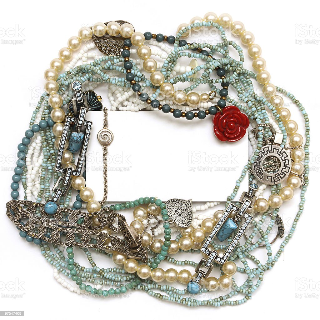 Frame of jewelry: silver, turquoise, pearls, coral, platinum and diamonds royalty-free stock photo