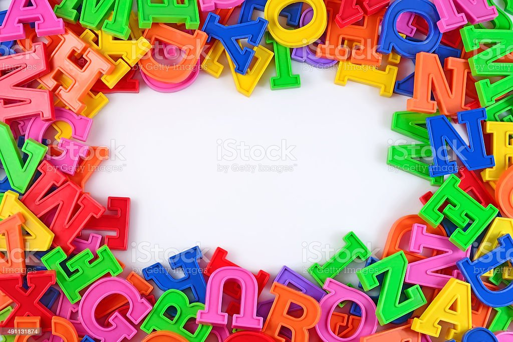 Frame of plastic colorful alphabet letters on a white stock photo